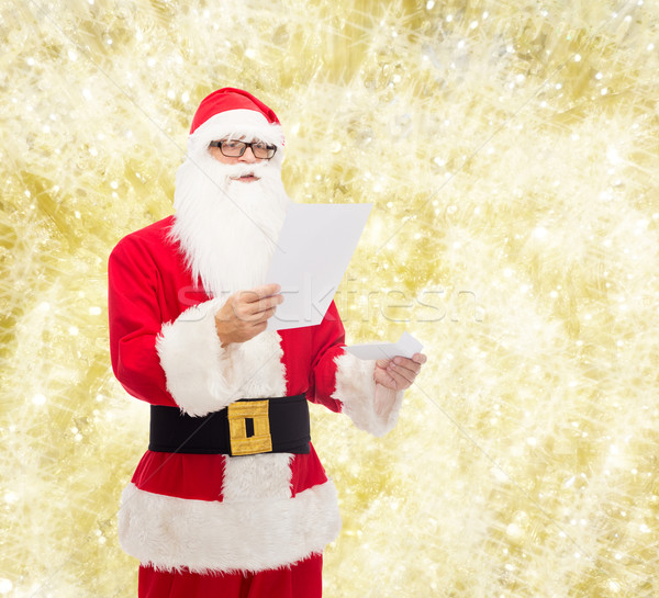 man in costume of santa claus with letter Stock photo © dolgachov