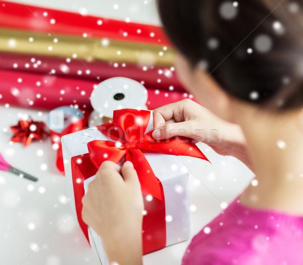 close up of woman decorating christmas present Stock photo © dolgachov
