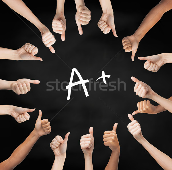 hands showing thumbs up in circle over a mark Stock photo © dolgachov