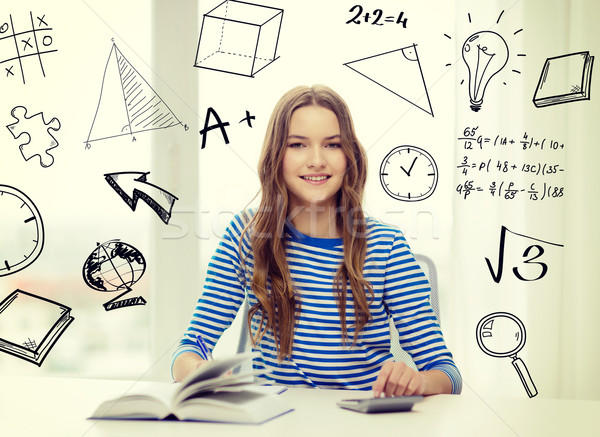 student girl with book, notebook and calculator Stock photo © dolgachov