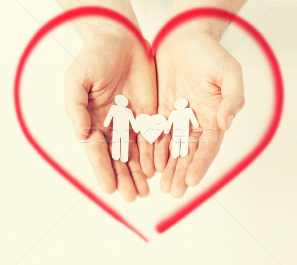Homme mains papier hommes famille amour Photo stock © dolgachov