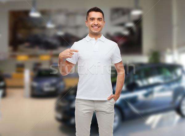 Mosolyog férfi póló mutat ujj boldogság Stock fotó © dolgachov