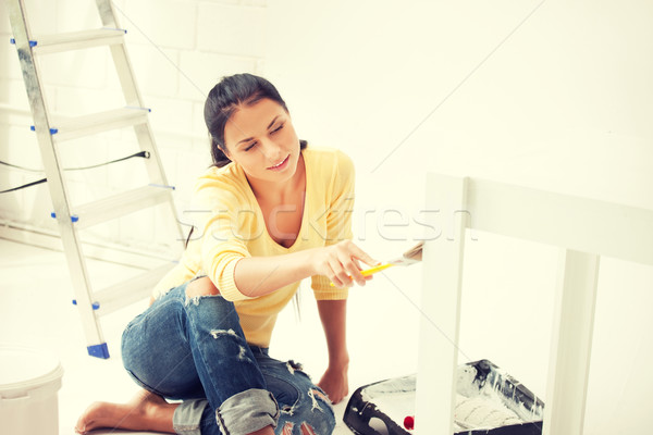 Stock photo: lovely housewife painting