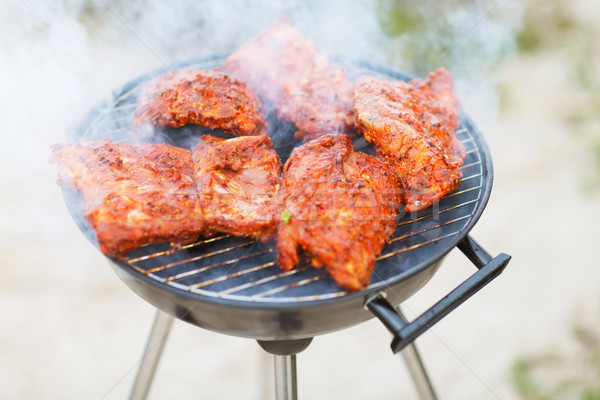 close up of meat on barbecue grill outdoors Stock photo © dolgachov