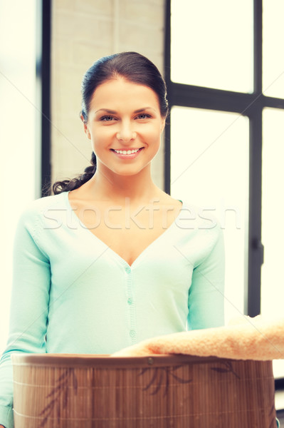 lovely housewife with towels Stock photo © dolgachov