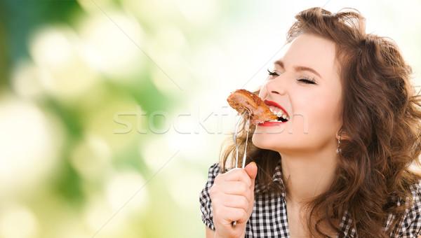 飢えた 若い女性 食べ 肉 フォーク 緑 ストックフォト © dolgachov
