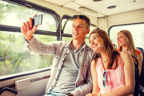 smiling couple with smartphone making selfie Stock photo © dolgachov