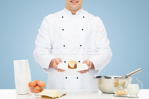 close up of happy male chef cook baking dessert Stock photo © dolgachov