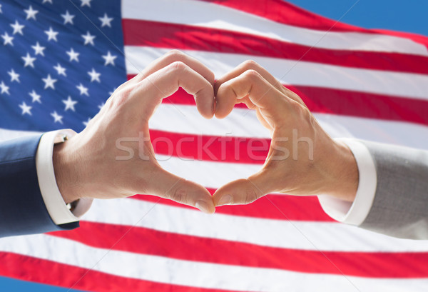 close up of male gay couple hands showing heart Stock photo © dolgachov