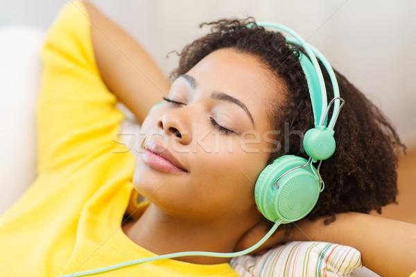 幸せ 女性 ヘッドホン 音楽を聴く 人 技術 ストックフォト © dolgachov