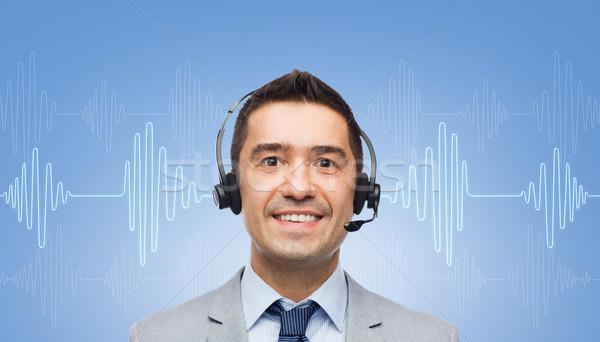 Foto d'archivio: Imprenditore · auricolare · onda · sonora · diagramma · uomini · d'affari · tecnologia