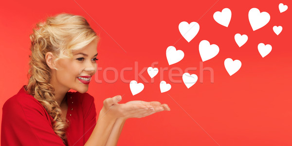 woman sending heart shapes from palms of her hands Stock photo © dolgachov