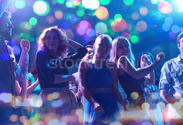 Csoport boldog barátok tánc éjszakai klub buli Stock fotó © dolgachov