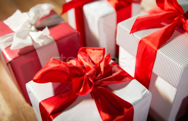 close up of gift boxes on wooden floor Stock photo © dolgachov