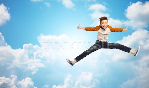 Feliz sonriendo nino saltar aire felicidad Foto stock © dolgachov