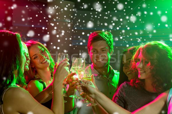 Sorridere amici occhiali champagne club capodanno Foto d'archivio © dolgachov