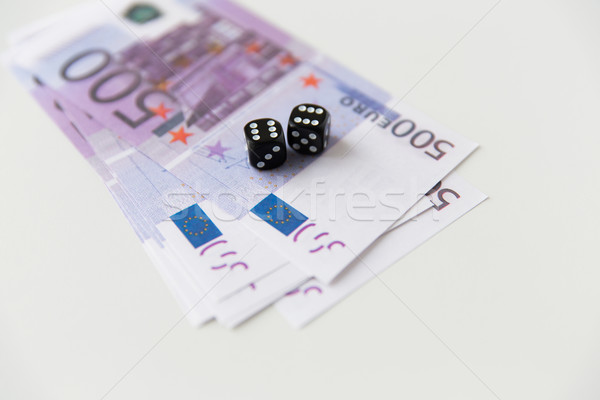 close up of black dice and euro cash money Stock photo © dolgachov