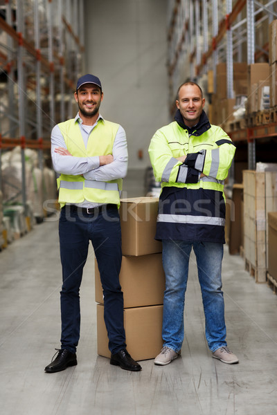 men in uniform with boxes at warehouse Stock photo © dolgachov