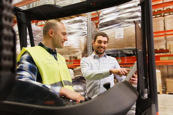 Boldog férfiak táblagép targonca raktár nagybani eladás Stock fotó © dolgachov