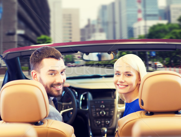 happy couple driving in cabriolet car over city Stock photo © dolgachov