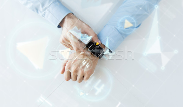 hand with smartwatch and virtual screen projection Stock photo © dolgachov