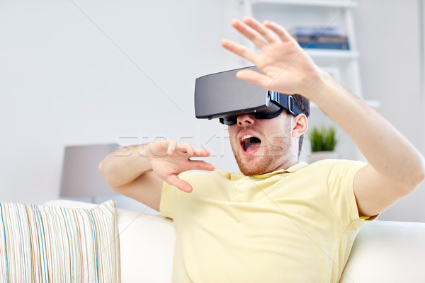 Stock photo: young man in virtual reality headset or 3d glasses