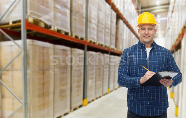 Gelukkig man helm magazijn groothandel Stockfoto © dolgachov