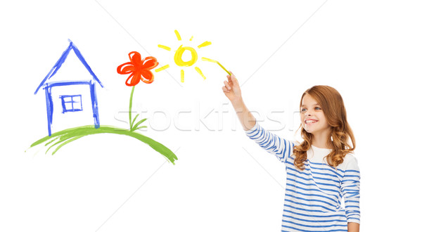 girl drawing house in the air Stock photo © dolgachov