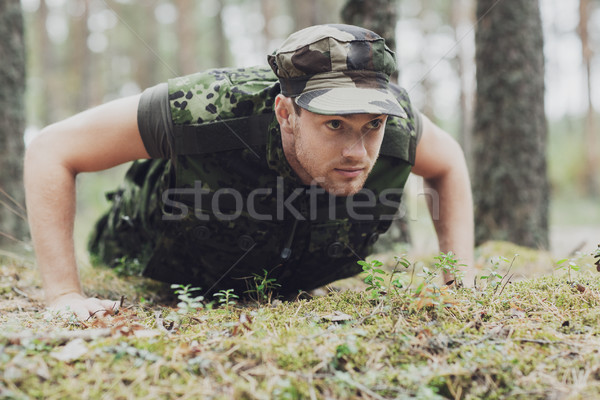 young soldier or ranger doing push-ups in forest Stock photo © dolgachov