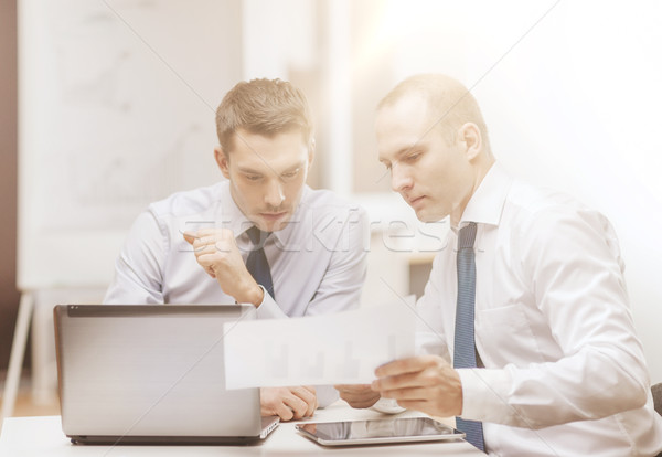 two businessmen having discussion in office Stock photo © dolgachov