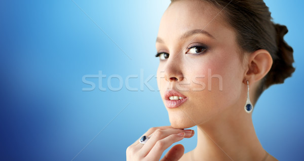 beautiful woman with earring and finger ring Stock photo © dolgachov