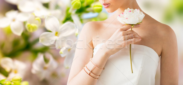 close up of beautiful woman with ring and bracelet Stock photo © dolgachov