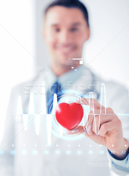 male doctor with heart and cardiogram Stock photo © dolgachov