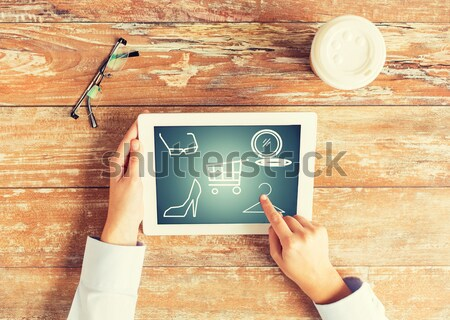 close up of female hands with tablet pc and coffee Stock photo © dolgachov