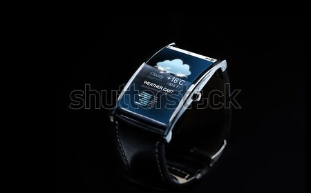 close up of smart watch with weather forecast Stock photo © dolgachov