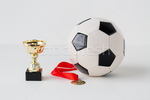 Közelkép futball labda arany csésze érem Stock fotó © dolgachov