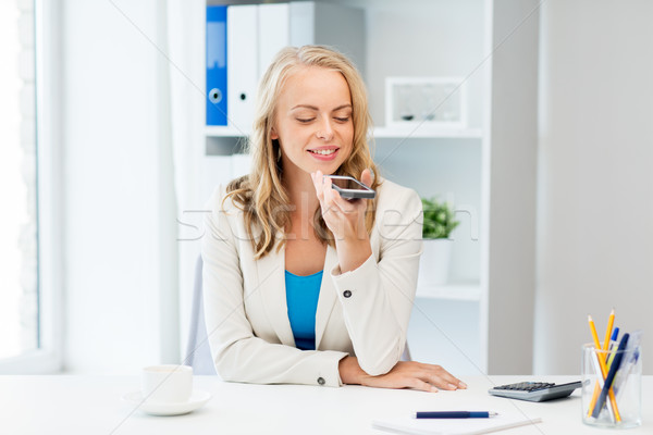 businesswoman using voice command on smartphone Stock photo © dolgachov