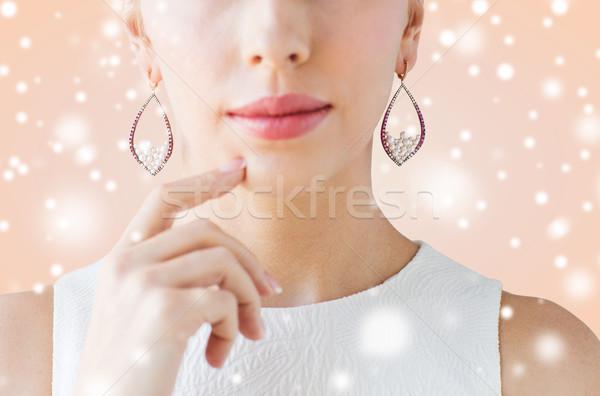 Közelkép gyönyörű nő arc fülbevalók karácsony ünnepek Stock fotó © dolgachov