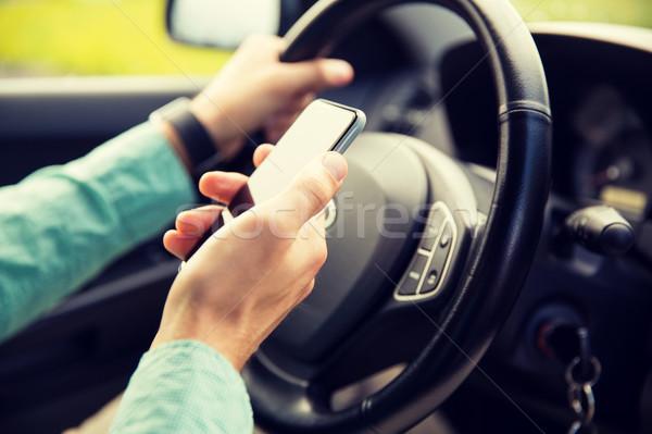 человека стороны смартфон вождения автомобилей Сток-фото © dolgachov