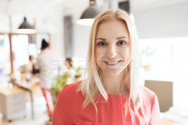 happy creative woman at office or bureau Stock photo © dolgachov
