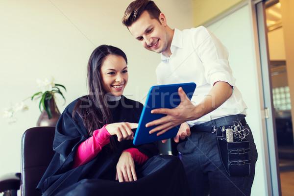 Heureux femme styliste salon beauté Photo stock © dolgachov