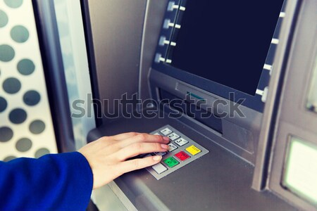 hands with money and credit card at atm machine Stock photo © dolgachov