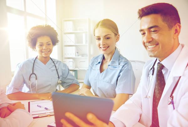 Feliz médicos reunión hospital médicos Foto stock © dolgachov