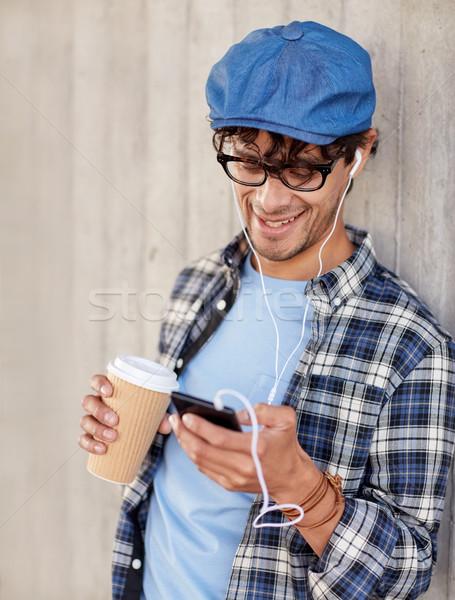 человека смартфон питьевой кофе люди Сток-фото © dolgachov