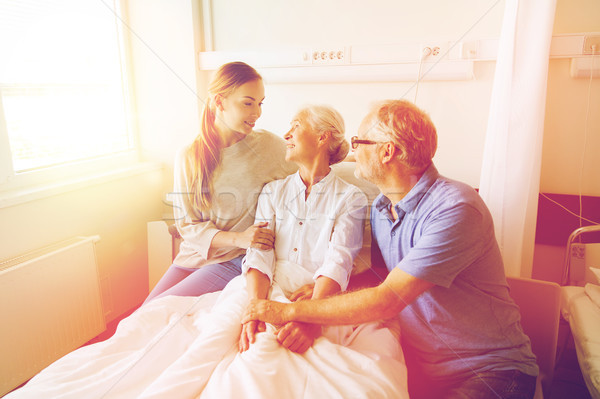 happy family visiting senior woman at hospital Stock photo © dolgachov