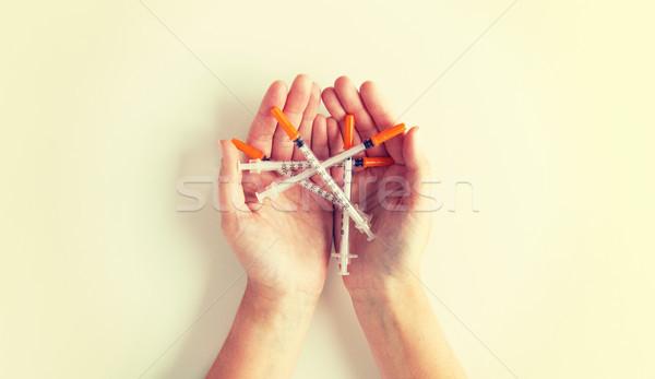 close up of woman hands holding syringes Stock photo © dolgachov
