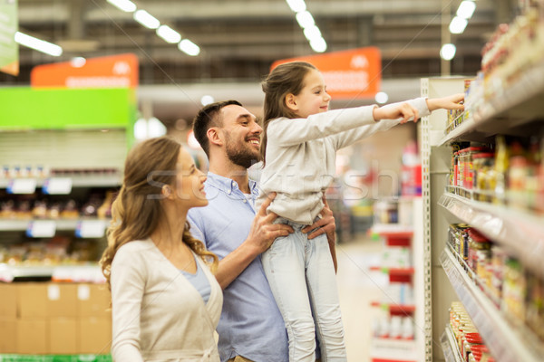 happy family buying food at grocery store Stock photo © dolgachov