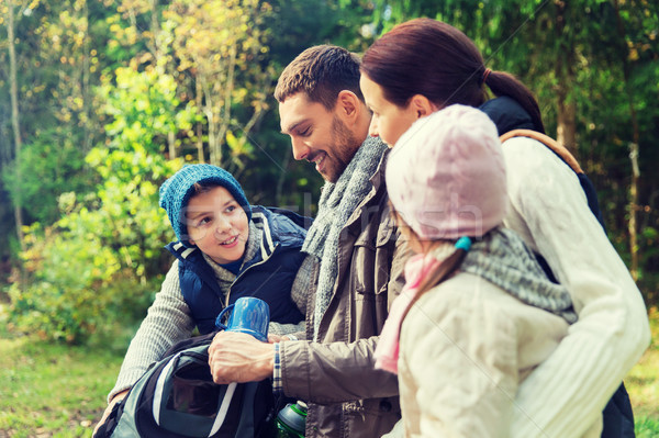 happy family with backpacks and thermos at camp Stock photo © dolgachov