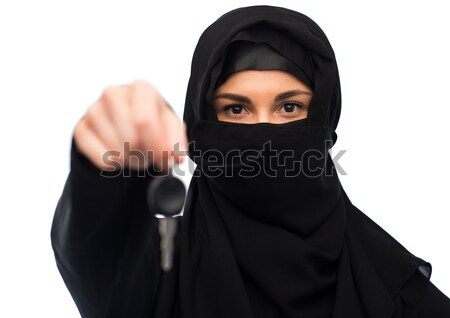 muslim woman in hijab with car key over white Stock photo © dolgachov