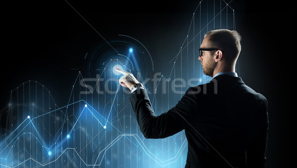 businessman with virtual diagram chart projection Stock photo © dolgachov